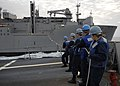US Navy 091116-N-9520G-103 Sailors assigned to the Arleigh Burke-class guided-missile destroyer USS Mustin (DDG 89) man the phone and distance line during an underway replenishment.jpg