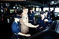 US Navy 091207-N-9737A-002 Air Force Major Gen. Stephen L. Hoog discusses the use of surface RADAR in tactical navigation with Ensign Caroline Adler and Ensign Travis King.jpg