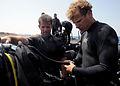 US Navy 100325-N-0553R-092 Explosive Ordnance Disposal Technician 2nd Class Rob Gangewer pre-checks his scuba gear prior to an open water dive.jpg