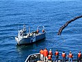 US Navy 100429-N-6141B-003 In an undated file photo, a rapid-deployment skimmer system conducts oil spill response training.jpg