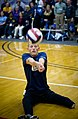 US Navy 100511-N-6932B-190 Parachute Rigger 3rd Class Michael Johnston bump-passes the ball to a teammate during a sitting volleyball game against the Army team at the inaugural Warrior Games.jpg
