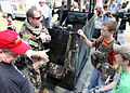 US Navy 100522-N-4205W-006 A special warfare combatant-craft crewmen assigned to Special Boat Team 22 explains the weapons aboard the special operations craft Riverine during the annual Trail of Honor.jpg