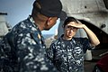 US Navy 100623-N-5319A-004 Ship's Serviceman 1st Class Garnet Valenzuela speaks with Chief Master-at-Arms Gerard Icar aboard the amphibious transport dock ship USS New Orleans (LPD 18).jpg
