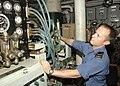 US Navy 100718-N-0000H-033 Able Seaman Daniel Graham, from Abbotsford, British Columbia, a marine engineer mechanic aboard the Canadian navy multi-role patrol frigate HMCS Calgary monitors the ship's reverse osmosis desalinatio.jpg