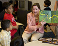 US Navy 100810-N-2389S-059 The wife of Vice Adm. Peter Daly reads to children at a Chicago YMCA as part of Chicago Navy Week.jpg