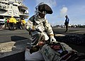 US Navy 100813-N-0569K-117 A member of the crash and salvage team assesses a Sailor's mock injuries during emergency drills on the flight deck of USS Enterprise (CVN 65).jpg