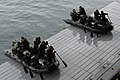 US Navy 110225-N-1911J-160 Soldiers from the Japan Ground Self-Defense Force launch rigid-hull inflatable boats from the well deck of USS Makin Isl.jpg