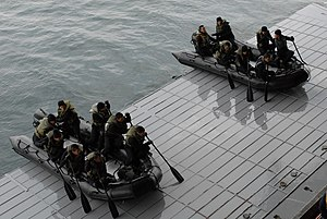 Western Army (Japan) - PACIFIC OCEAN (Feb. 25, 2011) Soldiers from the Japan Ground Self-Defense Force, Western Army Infantry Regiment launch rigid-hull inflatable boats from the well deck of the amphibious assault ship USS Makin Island (LHD 8). Marines and Japanese soldiers are participating in Exercise Iron Fist, a bilateral training exercise to enhance their amphibious knowledge. (U.S. Navy photo by Aviation Structural Mechanic Airman Justin Joyner/Released)
