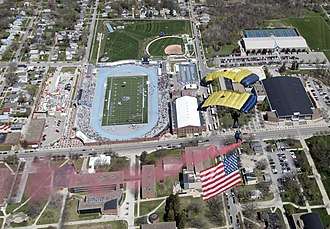 Drake Stadium (Drake University) - Image: US Navy 110429 N 0000W 312 Members of the U.S. Navy parachute demonstration team, the Leap Frogs, perform above Drake Stadium during the opening ce