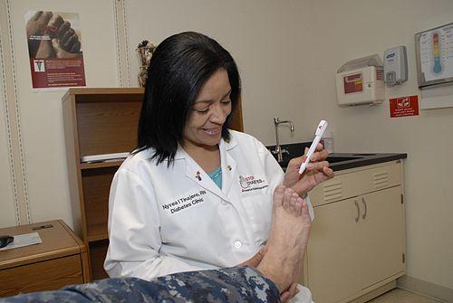 US Navy 111104-N-PE811-001 Naval Hospital Jacksonville diabetes education nurse Nyve Tinajero checks a patient's foot in the hospital's diabetes ce.jpg