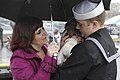 US Navy 111110-N-UM744-002 Machinist's Mate 1st Class Paul Rich hugs his 14-week old son for the first time.jpg