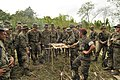 US Navy 111128-N-ZR315-077 A member of the Guatemalan special forces shows methods of preparing fish to U.S. Marines.jpg
