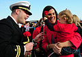 US Navy 111215-N-HG315-005 A Sailor hands his daughter a rose.jpg