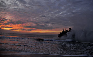 US Navy 120206-N-KB666-048 A landing craft air cushion (LCAC) returns to the amphibious assault ship USS Kearsarge (LHD 3) during a Bold Alligator.jpg