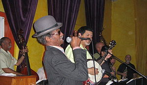 """Lionel Batiste - """"Uncle"""" Lionel Batiste (in derby hat) with  """"Papa"""" Don Vappie (with banjo)"""