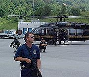 U.S. Marshals observing a prisoner transport to prevent escapes