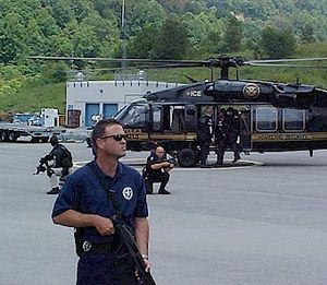Prisoner transport - United States Marshals securing an immigration and customs prisoner transport.