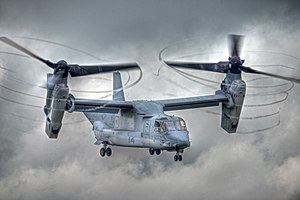 Bell Boeing V-22 Osprey - V-22 with rotors tilted, condensation trailing from propeller tips