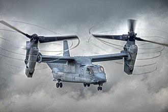 Bell Boeing V-22 Osprey - V-22 with rotors tilted, condensation trailing from propeller tips