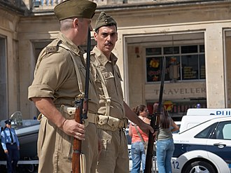 Royal Malta Artillery - Soldiers from a RMA living history group wearing WWII-era Khaki Drill uniforms and carrying .303 SMLE rifles on guard duty in Valletta in 2008