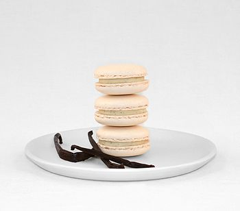 Vanilla macarons with vanilla pods for decoration