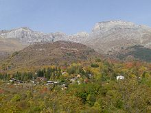 Village in autumn, with mountains in background