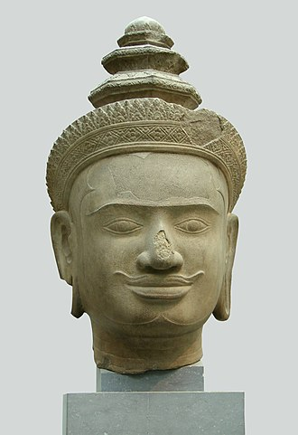 Phnom Bok - Head of Vishnu in sandstone from the Phnom Bok in Bakheng style now in Guimet Museum in Paris.