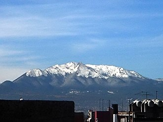 Ajusco - Snow-covered Ajusco volcano as seen from Colonia Narvarte in Mexico City