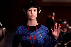 Vulcan (Star Trek) - A female Star Trek Vulcan cosplayer demonstrating the Vulcan salute
