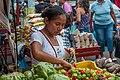 Woman buying peppers.jpg