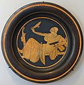 Woman playing kottabos, plate, by the Bryn Mawr Painter, Attic Greek, c. 480 BC, red-figure terracotta - Sackler Museum - Harvard University - DSC01771.jpg