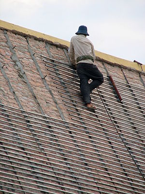 300px Worker fixing the roof of building in Royal Palace Cambodia 12 Steps To Rehabbing a House