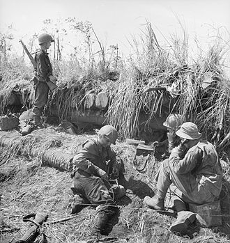 Battle of Buna–Gona: Japanese forces and order of battle - American signallers operating beside a captured Japanese bunker at Buna.  AWM013979