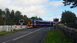 158709 crossing Lairg level crossing (15072264448).jpg