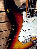 1963 Stratocaster with alder body, rosewood finger board, three-ply pickguard and three-color sunbirth finish