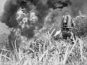 2/8th Battalion (Australia) - An Australian infantrymen uses a flamethrower against Japanese positions in Wewak, 1945