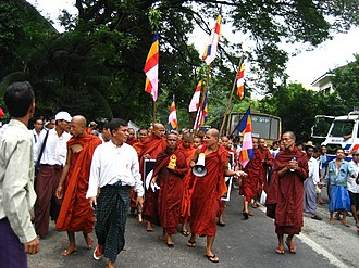 Saffron Revolution - Monks protesting in Yangon, carrying the Buddhist flag