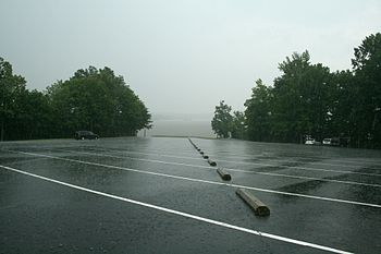 English: access area parking lot in the rain. ...