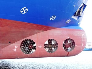 "Manoeuvring thruster - A ship equipped with tunnel thrusters, marked by the circled-x symbols ""(x)"" above the water line"
