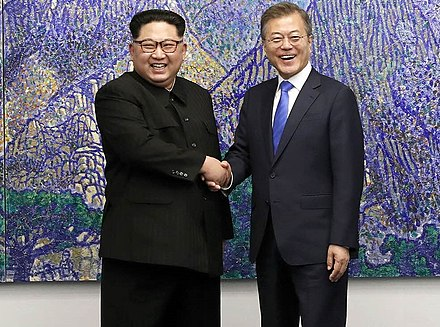 North Korean leader Kim Jong-un and South Korean President Moon Jae-in shake hands inside the Peace House. 2018 inter-Korean summit 01 (cropped).jpg