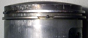 Piston ring - A pair of piston rings mounted on a 47mm two-stroke cycle scooter piston.