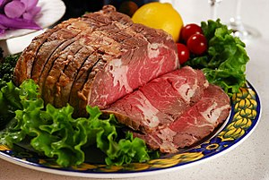 a chunk of beef with salad