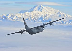A C-130J Super Hercules from the 41st Airlift Squadron flies past Denali (28124438444).jpg
