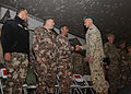 A Polish commander, right foreground, shakes hands with official party members during a change of command ceremony for the Jordanian Armed Forces, Task Force 222 at Bagram Airfield in Parwan province 131221-A-RU942-132.jpg