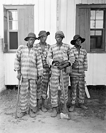 A chain gang of African American prisoners in the old South of the USA as sung in the lyrics of Dani California song