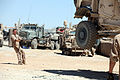 A U.S. Marine holds a chain to steady a mine-resistant, ambush-protected all-terrain vehicle suspended in the air while a lift slides underneath at Forward Operating Base (FOB) Edinburgh, Afghanistan, June 20 110620-M-UV027-020.jpg