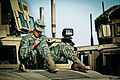 A U.S. Soldier with the 1st Brigade Combat Team, 34th Infantry Division writes a letter during a deployment at Camp Arifjan, Kuwait, Oct. 9, 2011, in support of Operation New Dawn 111009-A-HN532-761.jpg