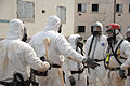 A U.S. military service member undergoes decontamination as others observe during a joint training exercise conducted by the U.S. Air Force and the U.S. Army involving biological and chemical warfare response 080626-A-BB257-092.jpg