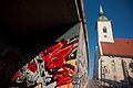 A graffiti pattern in the historical centre of Bratislava at the background of The Old Town Hall And Jesuit Church. Slovakia, Eastern Europe, October 20, 2012-2.jpg