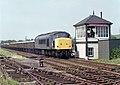"A granite train passing Desford Colliery Sidings signal box, hauled by 1-Co-Co-1 ""Peak"" no. 45001 (2) Nigel Tout, 4.7.85.jpg"